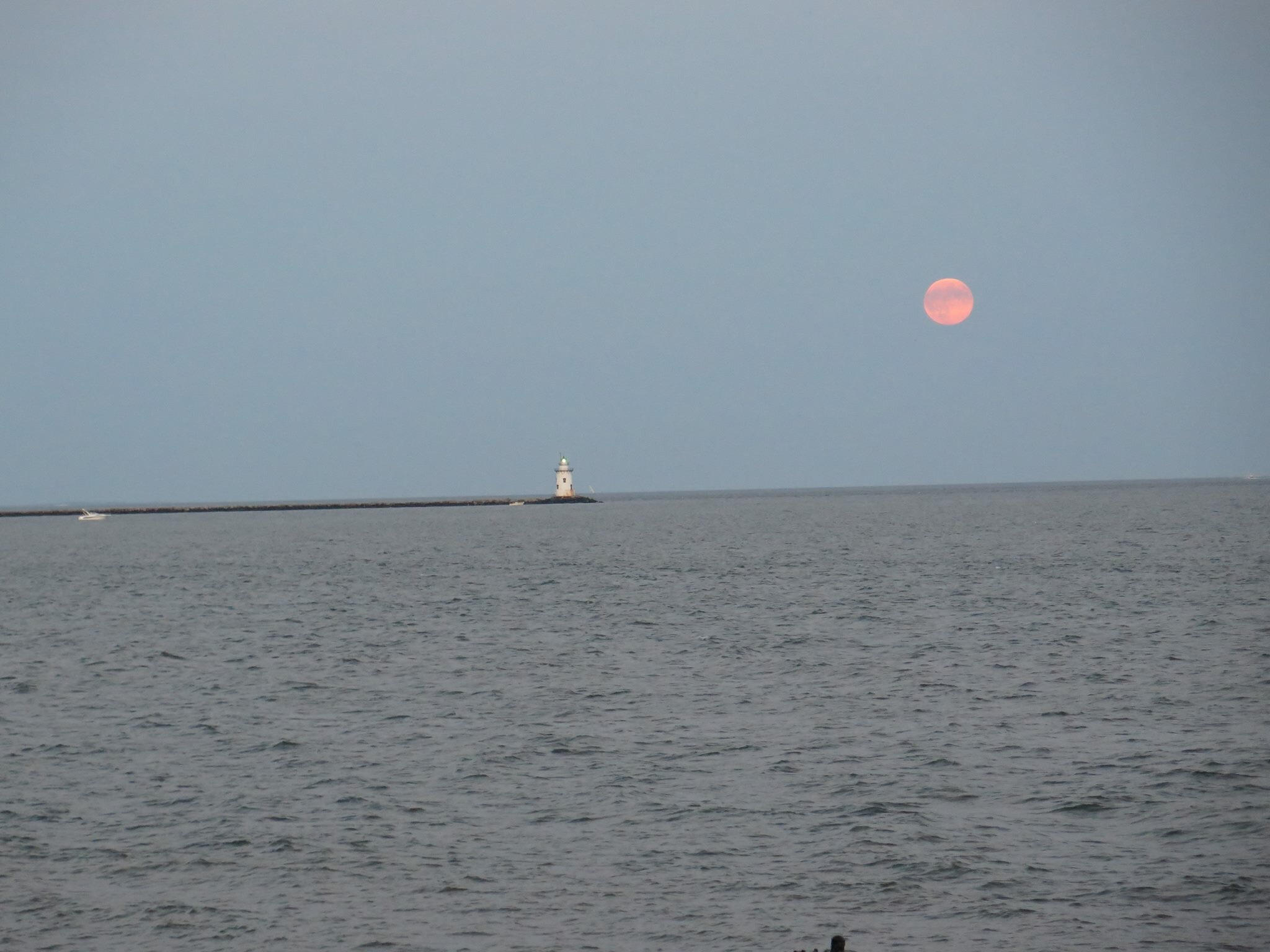 Supermoon over the Breakwater Lighthouse in Old Saybrook.