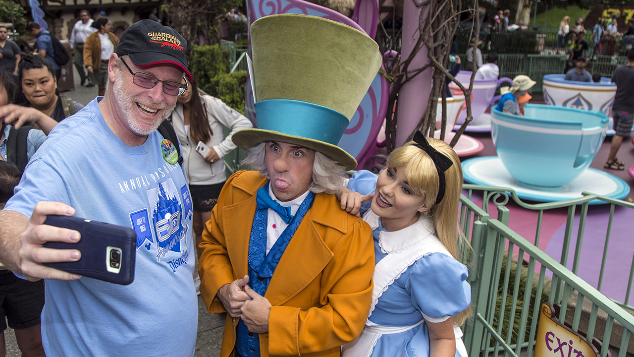 Huntington Beach resident Jeff Reitz, who has visited the parks of the Disneyland Resort every day since January 1, 2012, marked his 2,000th consecutive visit on Thursday. Here, Reitz snaps a selfie with The Mad Hatter and Alice after a teacup ride at the Mad Tea Party in Fantasyland at Disneyland during his 2,000th visit to the park.
