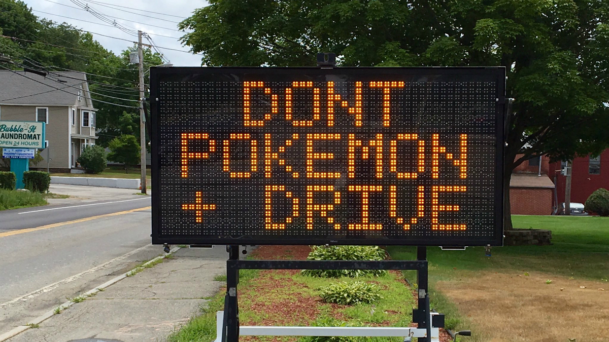 Ayer Police posted this photo on Twitter on Thursday, urging people not to play Pokemon Go while driving in New England.