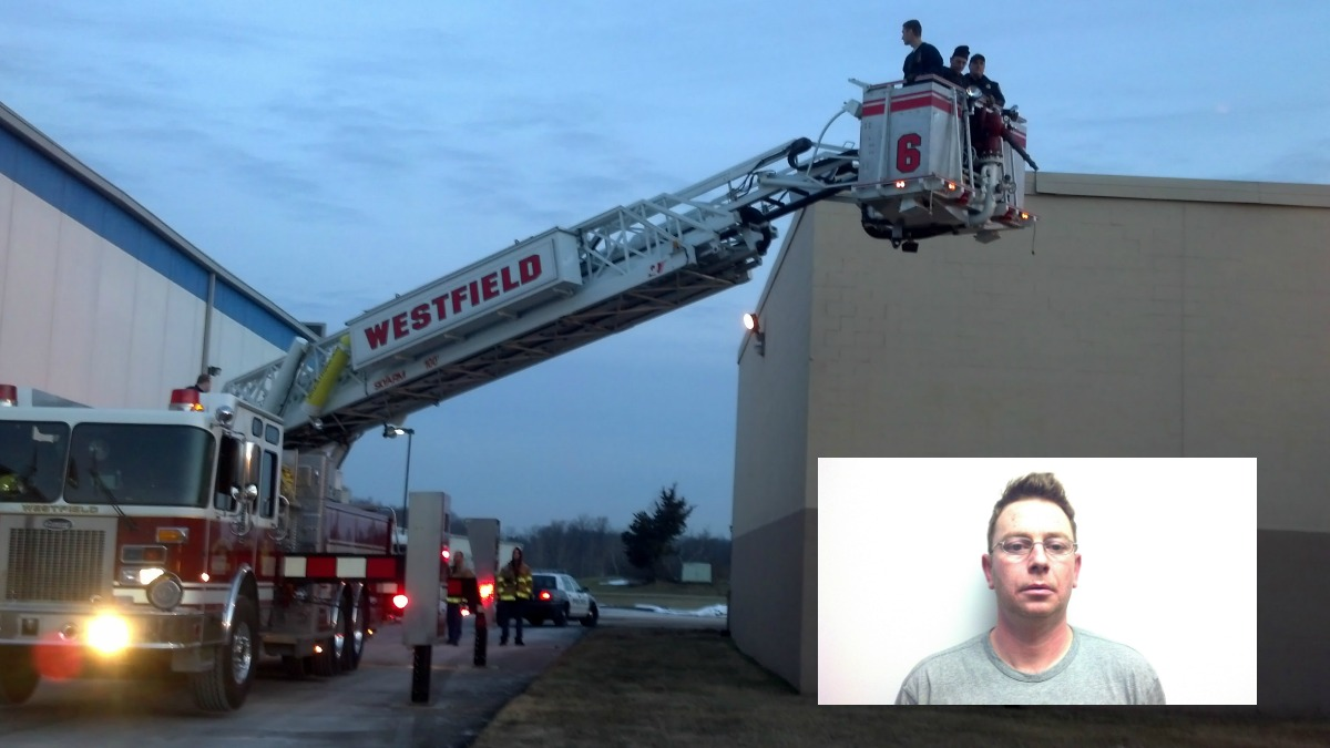 Middletown police, along with the Westfield Fire Department, arrested Roman Skrzypecki (inset) on the roof of Electrical Wholesalers.