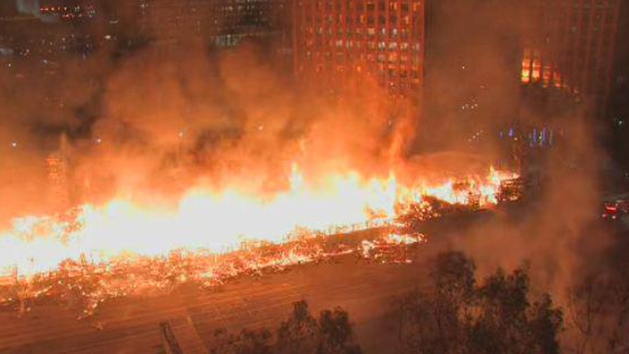 A massive fire raged at an apartment building that was under construction along the 110 Freeway in downtown LA on Monday, Dec. 8, 2014.