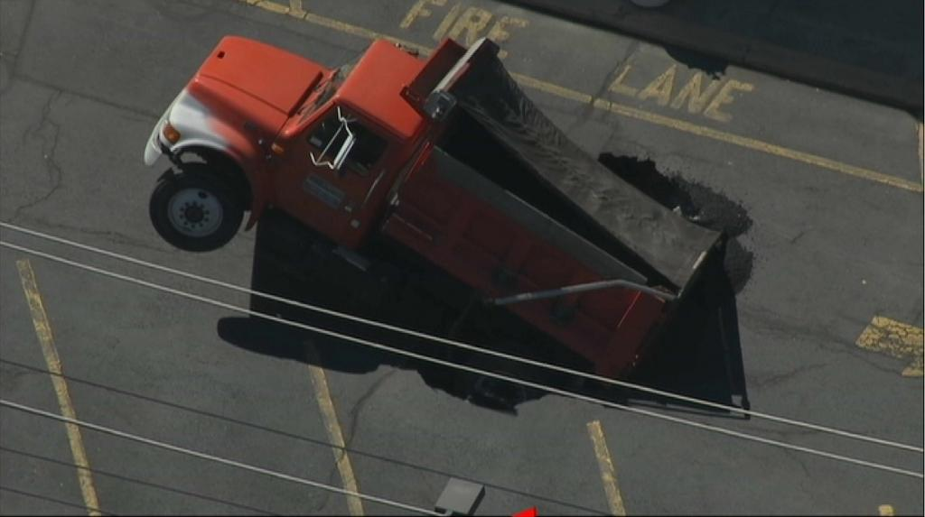 Chopper 4 captured this image of the truck in the sinkhole.