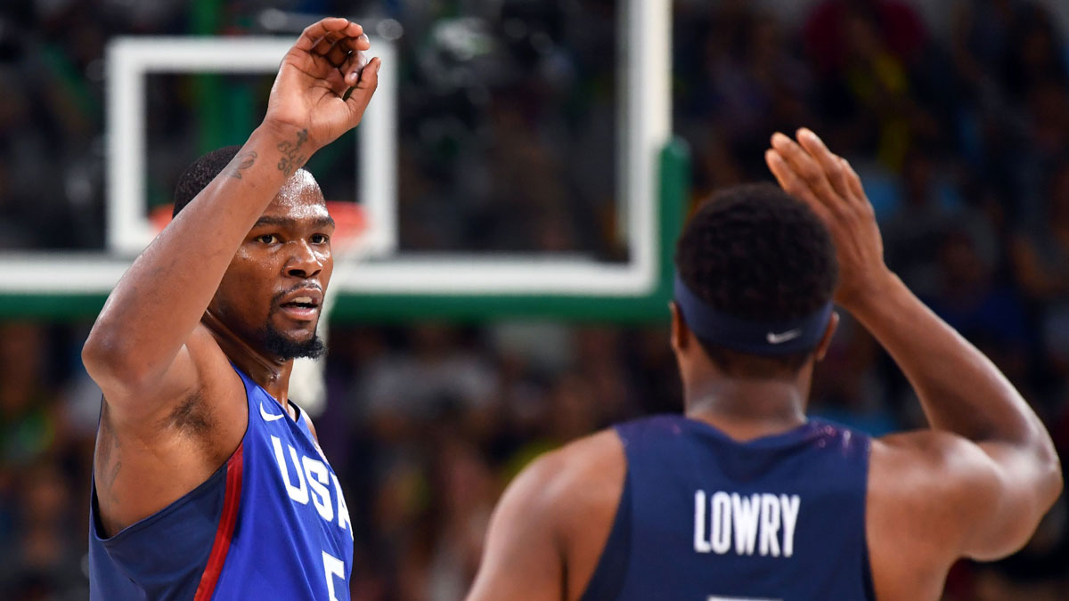 Kevin Durant and Kyle Lowry celebrate during the first half of the USA's basketball game against China at the Carioca Arena 1 in Rio de Janeiro on August 6, 2016, during the Rio 2016 Olympic Games.
