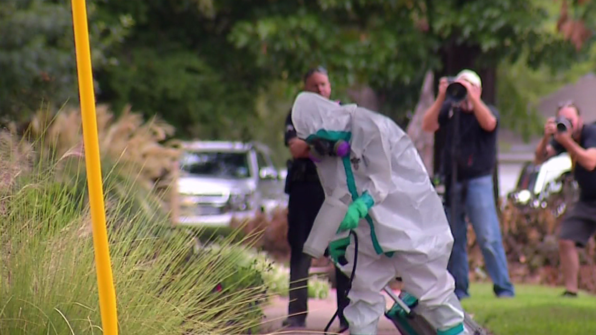 Clean-up after a nurse who treated an Ebola patient tested positive for the Ebola virus