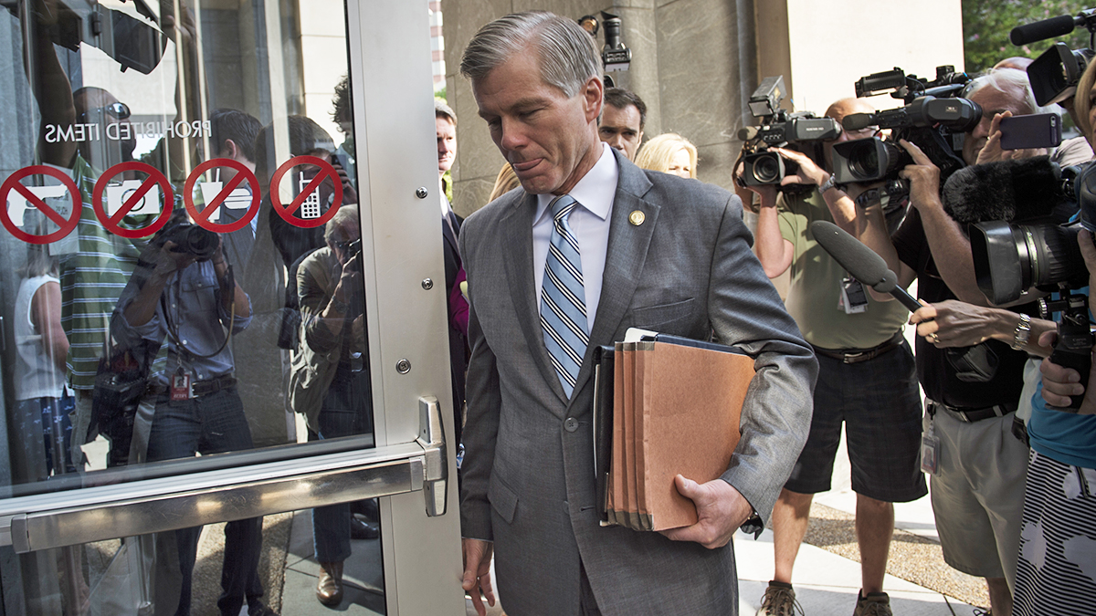 RICHMOND, VA  –  JULY 31:  Former Virginia Governor Bob McDonnell, surrounded by reporters, arrives for his trial at the Spottswood W. Robinson III and Robert R. Merhige, Jr., Federal Courthouse in Richmond, Virginia, on Thursday, July 31, 2014. (Photo by Nikki Kahn/The Washington Post)