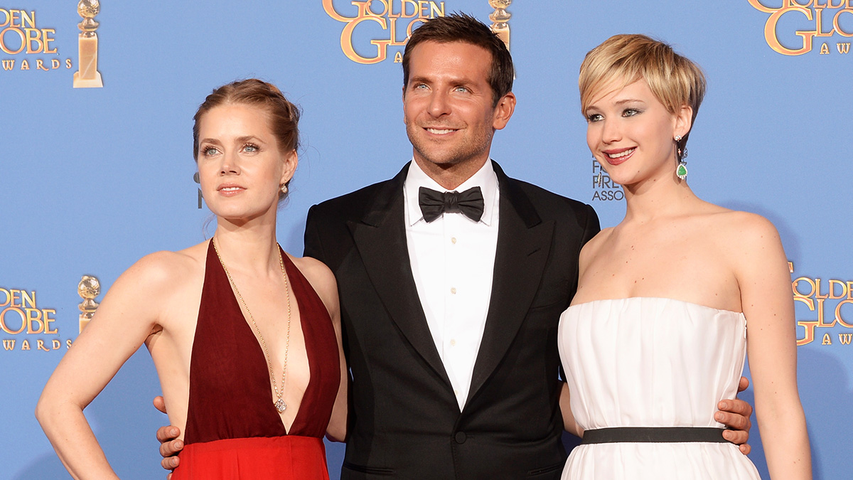 Actors Amy Adams, Bradley Cooper and Jennifer Lawrence, winners of Best Motion Picture - Musical or Comedy for 'American Hustle,' pose in the press room during the 71st Annual Golden Globe Awards held at The Beverly Hilton Hotel on January 12, 2014 in Beverly Hills, California.
