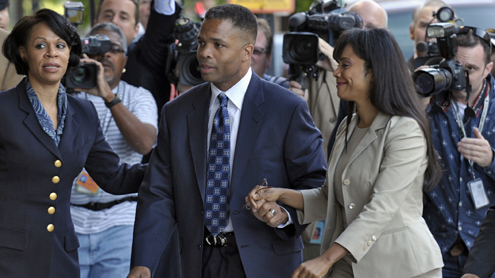 Former Illinois Rep. Jesse Jackson Jr. and his wife, Sandi, arrive at federal court in Washington, Wednesday, Aug. 14, 2013, to learn their fates when a federal judge sentences the one-time power couple for misusing $750,000 in campaign money on everything from a gold-plated Rolex watch and mink capes to vacations and mounted elk heads. (AP Photo/Susan Walsh)
