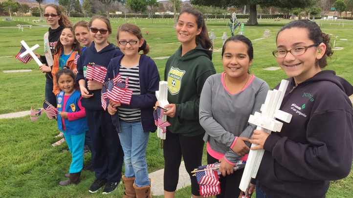 These Inland Empire girl scouts took from their cookie fund to replace grave-marking flags stolen from Elsinore Valley Cemetery before Memorial Day 2015.