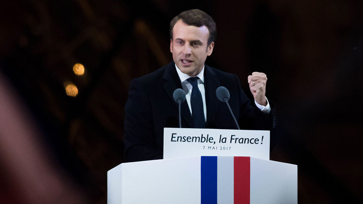 In this file photo, Emmanuel Macron adresses suporters after winning the French presidential election, at the Louvre on May 7, 2017, in Paris, France.