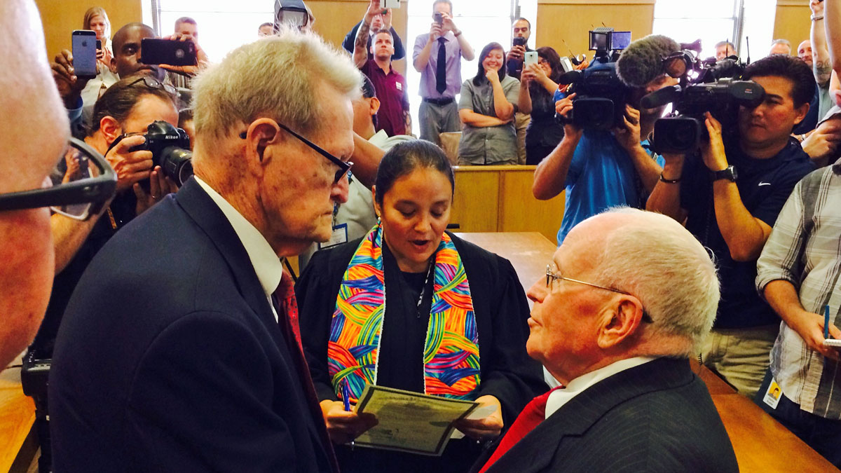 Jack Evans, 85, and George Harris, 82, who have been together for 54 years, received their license Friday and were married by Judge Dennise Garcia, a member of their church, hours after a landmark decision by the Supreme Court.