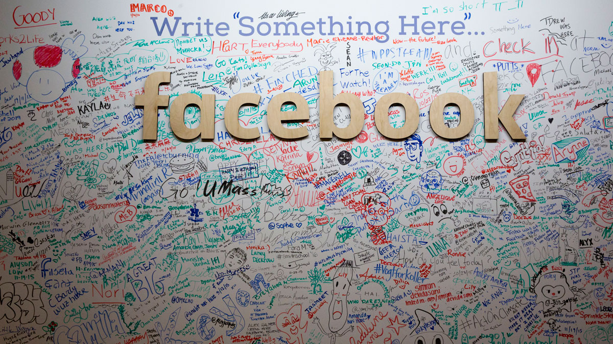 This file photo from Thursday, Feb. 18, 2016, shows the Facebook signature wall at the company's office in New York.