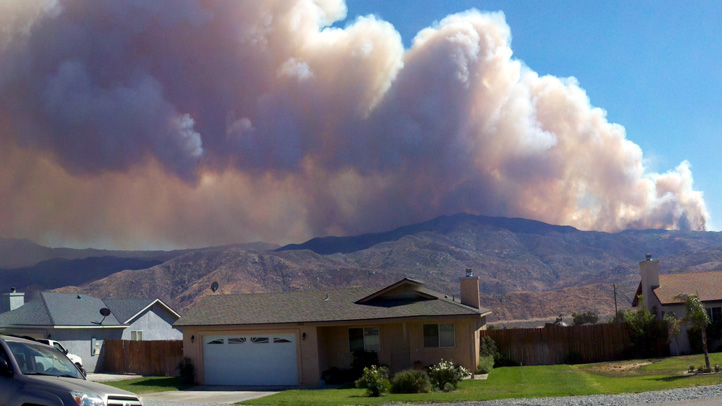 Viewer Image: Smoke from the Silver Fire near Cabazon billows over homes.