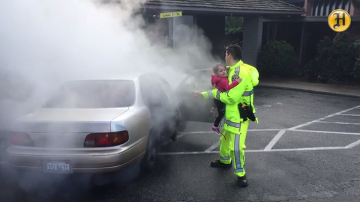 A California Highway Patrol officer pulled four people to safety, including two young children, after their car caught fire Monday morning in Monterey.