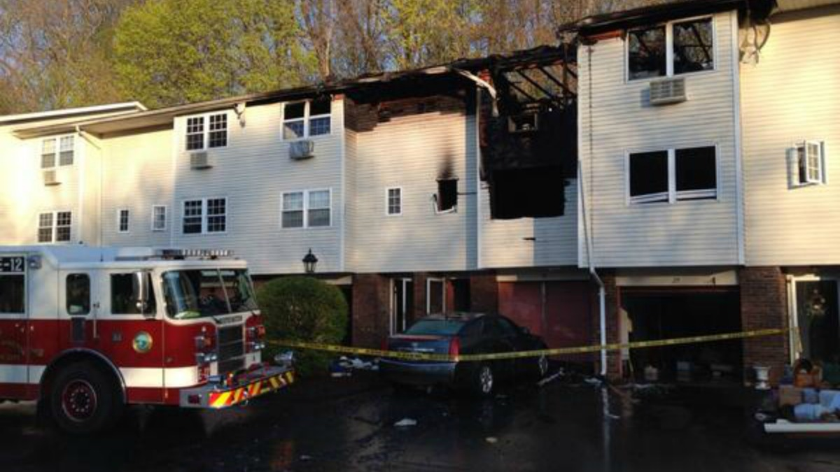 Officials are investigating a fire that tore through this Southington condo complex overnight, forcing one resident to jump from his second-story window.