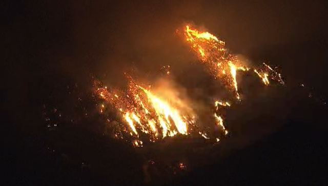 The 1,600 acre Santiago Fire burns up a hill in the Cleveland National Forest in Orange County on Friday, Sept. 12, 2014.
