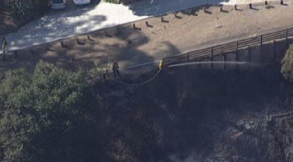 Fire crews battle a brush fire in Oakland Hills on Saturday afternoon.