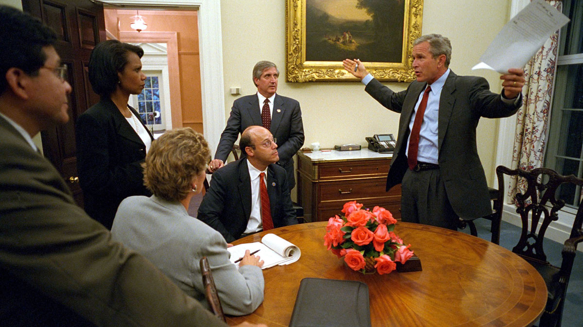 President George W. Bush speaks to his staff inside the private dinning room Sept. 11, 2001, at The White House prior to his address to the nation about the terrorist attacks on the U.S. With the president are (L to R) White House Counsel Al Gonzalez, National Security Adviser Condoleezza Rice, Presidential Counselor Karen Hughes, Press Secretary Ari Fleischer, and Chief of Staff Andy Card.