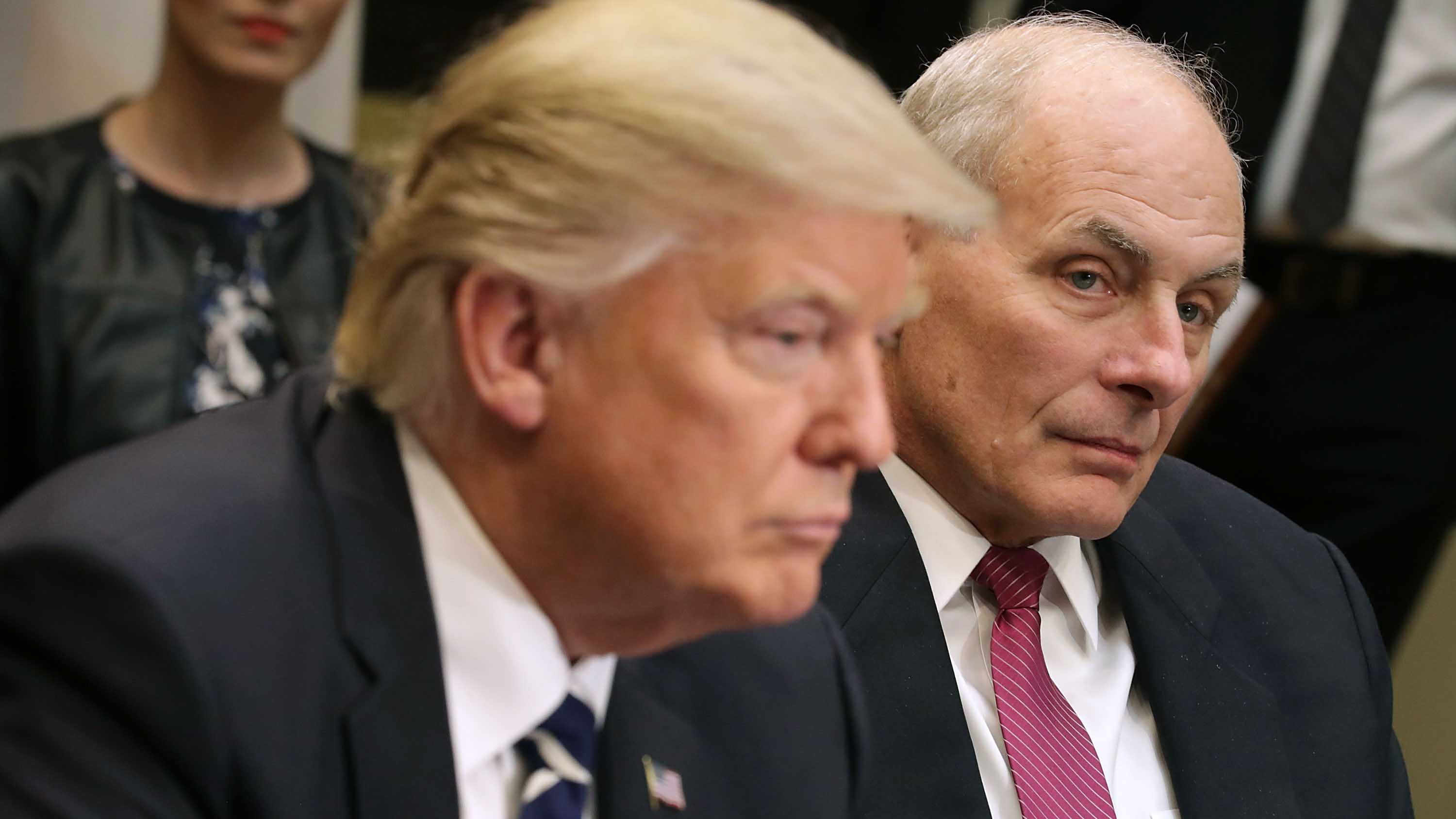 This January 31, 2017, file photo shows Homeland Security Secretary John Kelly listening as President Donald Trump speaks at a meeting with government cybersecurity experts at the White House.