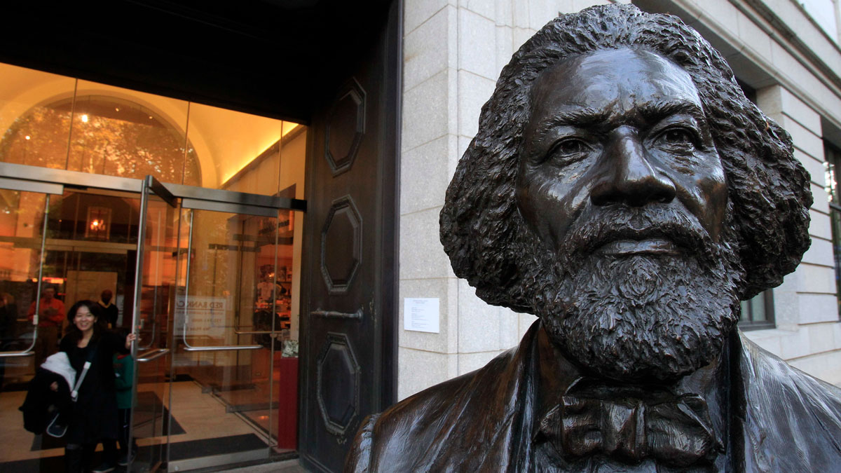 File Photo—This Nov. 8, 2011 photo shows a sculpture of Frederick Douglas outside of the New York Historical Society museum in New York. The New-York Historical Society has added a children's museum, loads of interactive features, and a motion-sensitive reproduction of a 19th-century painting.