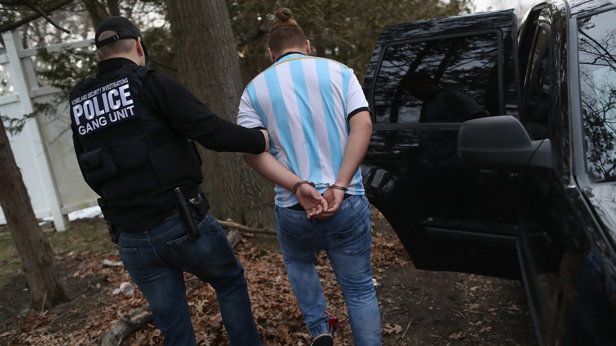 ICE agents detain a suspected MS-13 gang member and Honduran immigrant at his home on March 29, 2018 in Brentwood, New York.