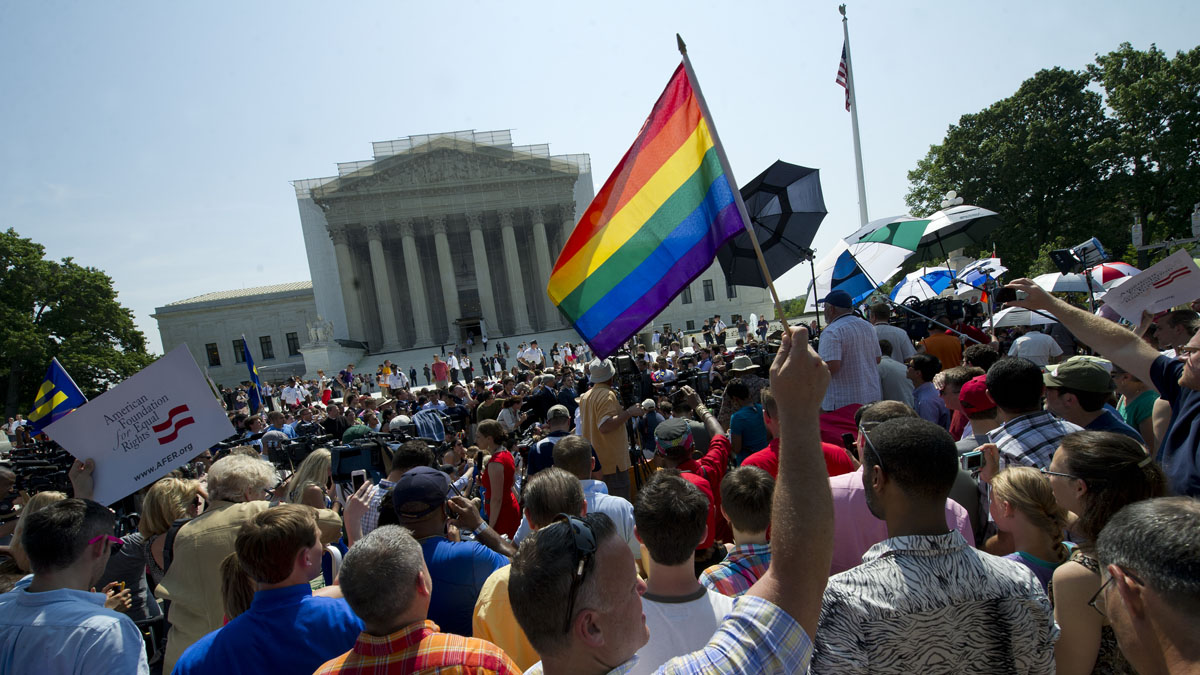 File photo: Gay and lesbian activists protest in front of the U.S. Supreme Court building on June 26, 2013 in Washington, DC. The protest turned to celebration when the high court ruled that married gay and lesbian couples are entitled to federal benefits, making the ruling a major victory for the gay rights movement.