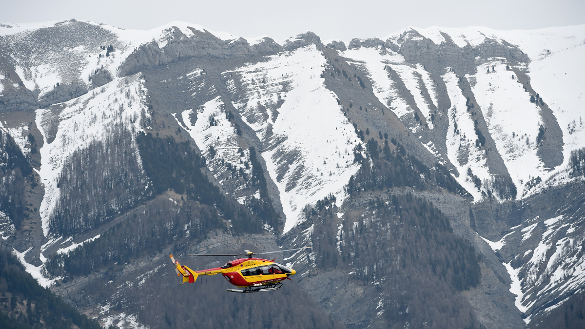A helicopter of the French civil security services flies near Seyne, south-eastern France, on March 24, 2015, near the site where a Germanwings Airbus A320 crashed in the French Alps.