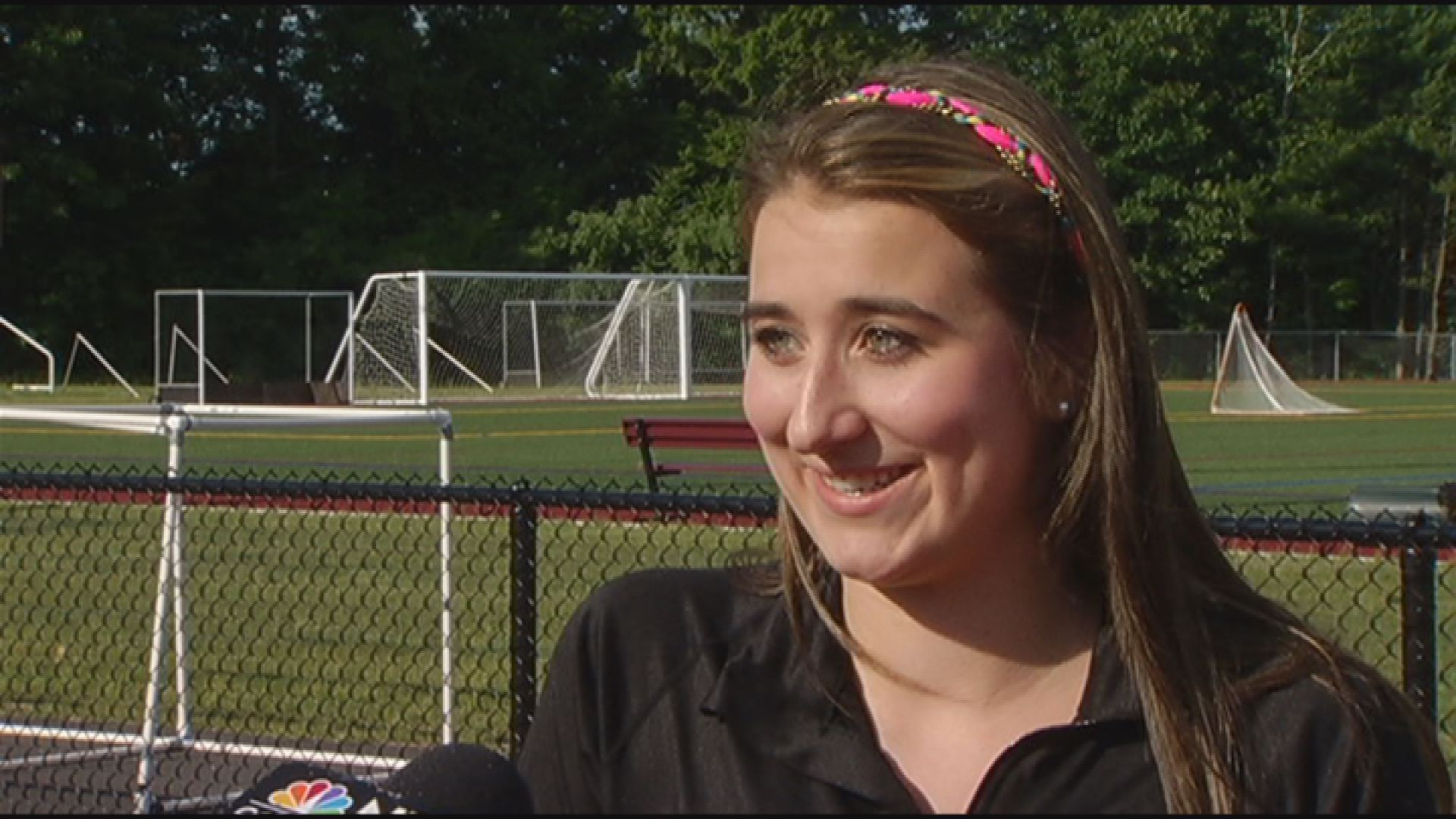 High school senior Cassia Shoaf is credited with helping to save the life of a man who collapsed on the school athletic fields.