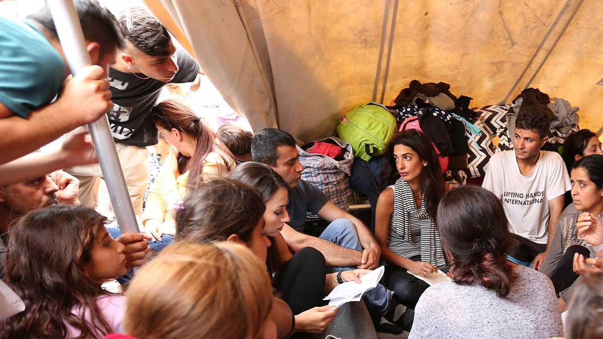Amal Clooney visits with Yazidi refugees at a camp in northern Greece.