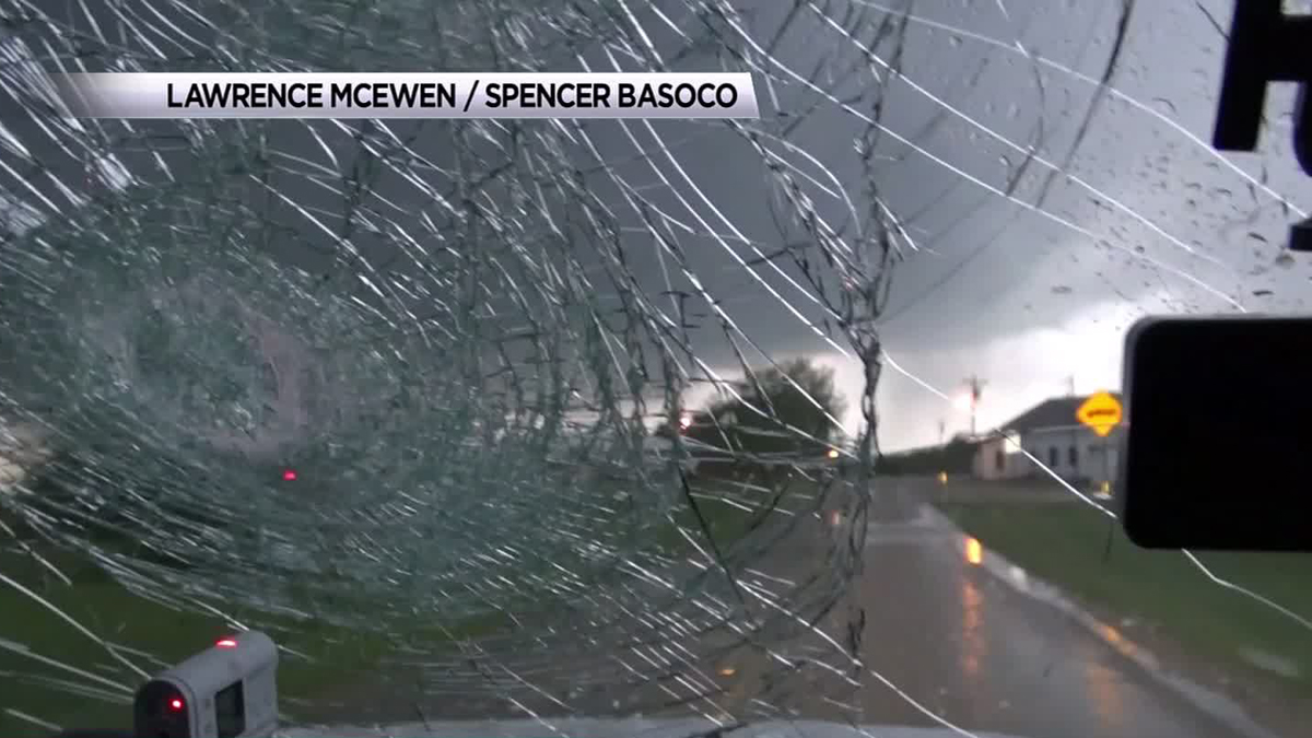 Hail stones about the size of softballs completely destroy the windshield of storm chasers' car near Stephenville Sunday.
