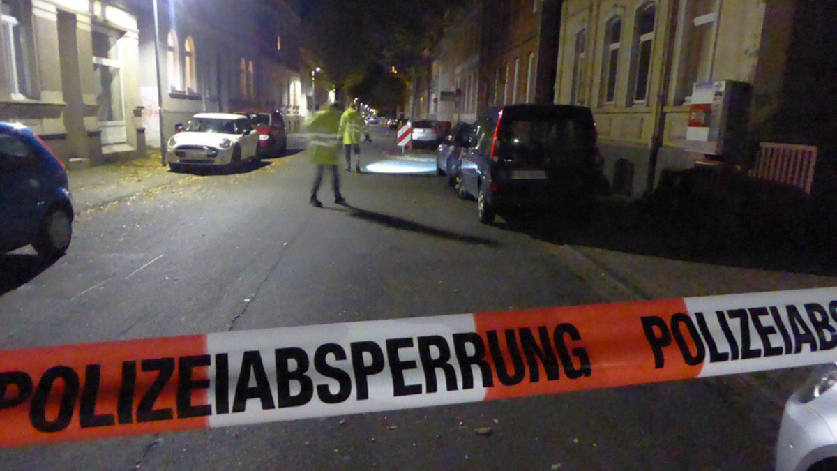 Police in Hamelin, Germany, investigate after a woman was dragged through the streets of the town behind a car on Sunday, November 20, 2016.