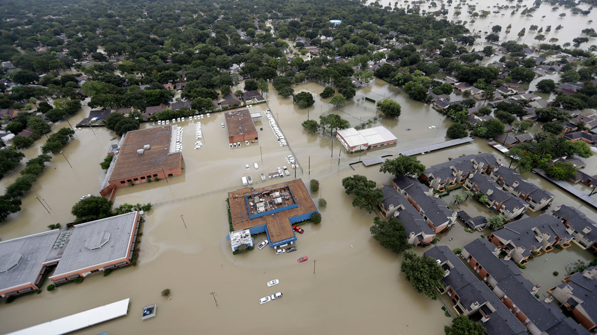 Businesses and neighborhoods near Addicks Reservoir is flooded by floodwaters from Tropical Storm Harvey Tuesday, Aug. 29, 2017, in Houston.