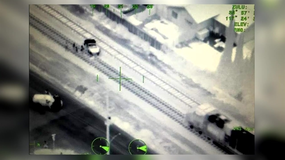 A helicopter helped a train avoid disaster by shining the spotlight to warn the engineer that the train was headed for a stalled car on the tracks on Saturday, April 24, 2016.