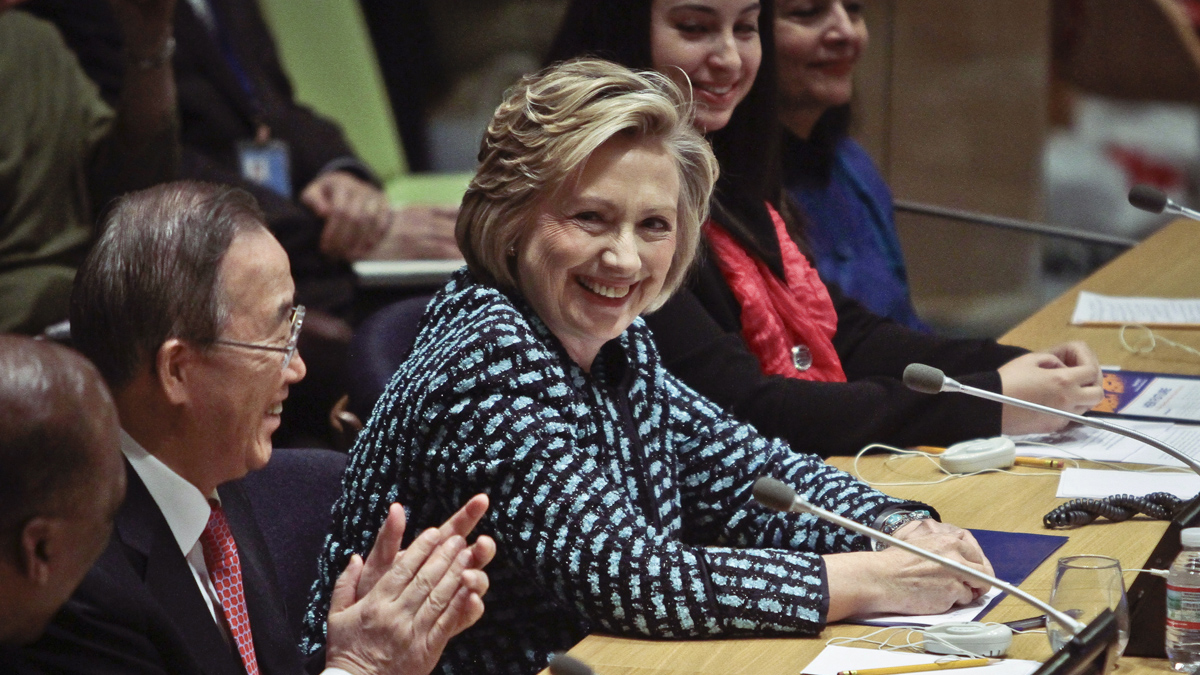U.N. Secretary-General Ban Ki-moon, second left, welcomes former United States Secretary of State Hillary Rodham Clinton, center, at a U.N. meeting to kick off events for the International Women's Day-8 March, Friday, March 7, 2014 at United Nations headquarters.