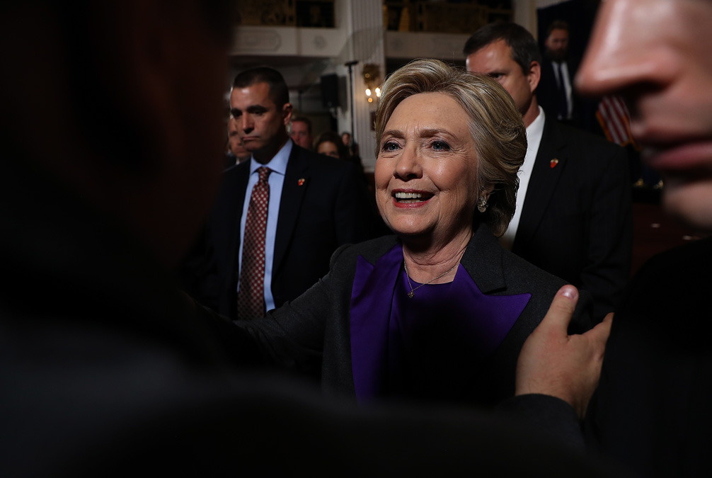 Former Secretary of State Hillary Clinton greets supporters and members of her staff during a news conference at the New Yorker Hotel on November 9, 2016 in New York City.