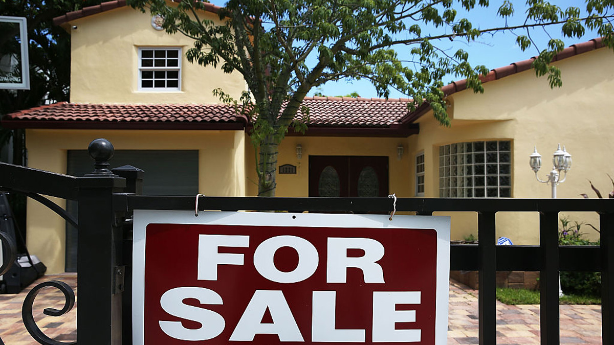 MIAMI, FL - AUGUST 21: A for sale sign is seen in front of a home on August 21, 2015 in Miami, Florida. According to the National Association of Realtors, U.S. home resales rose more than expected in July to their highest level since 2007.