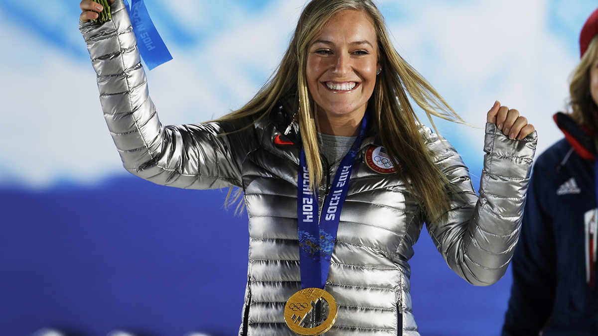 Gold medalist in the women's snowboard slopestyle Jamie Anderson of the United States smiles during the medals ceremony at the 2014 Winter Olympics, Sunday, Feb. 9, 2014, in Sochi, Russia. (AP Photo/Morry Gash)