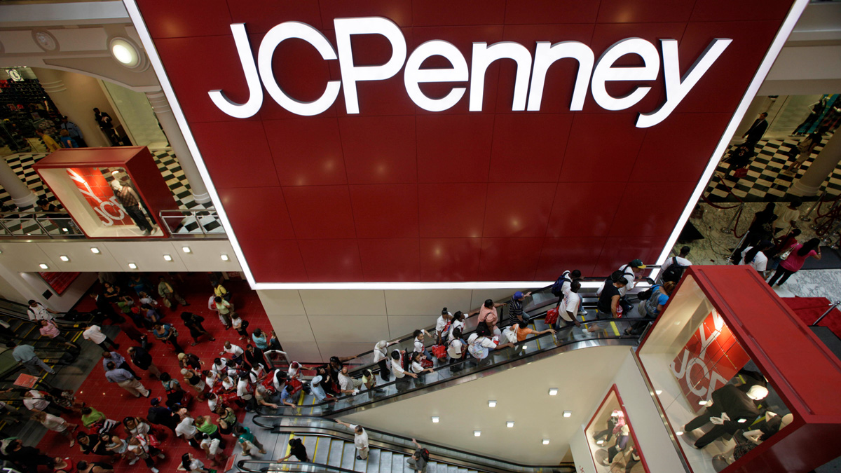 FILE - In this July 31, 2009 file photo, customers are seen in the main entrance of the new JCPenney store in the Manhattan Mall during the grand opening in New York.