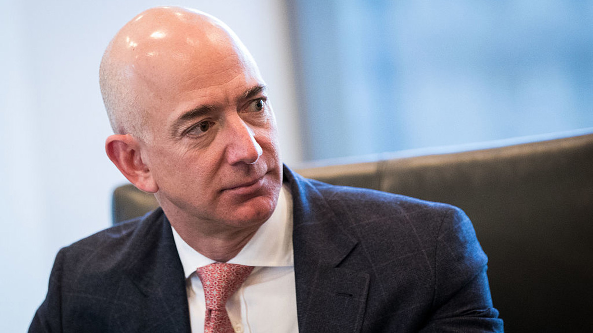 In this file photo, Jeff Bezos, chief executive officer of Amazon, listens during a meeting of technology executives and President-elect Donald Trump at Trump Tower, December 14, 2016 in New York City.