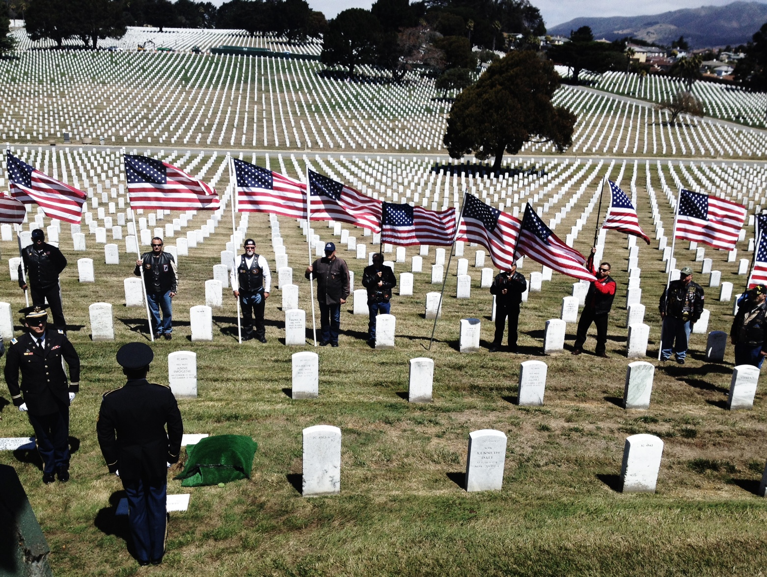 Army soldiers stand over the grave of Joseph Steinberg as the honor guard looks on in Golden Gate National Cemetery in San Bruno.