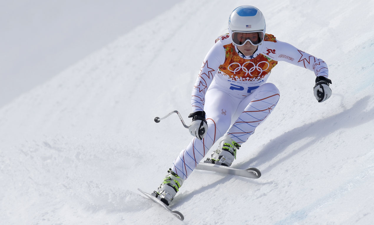 United States' Julia Mancuso makes a turn during the downhill portion of the women's super combined at the Sochi 2014 Winter Olympics, Monday, Feb. 10, 2014, in Krasnaya Polyana, Russia.