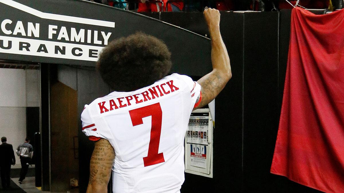 San Francisco 49ers quarterback Colin Kaepernick walks off the turf after an NFL football game against the Atlanta Falcons, Sunday, Dec. 18, 2016, in Atlanta. The Atlanta Falcons won 41-13.