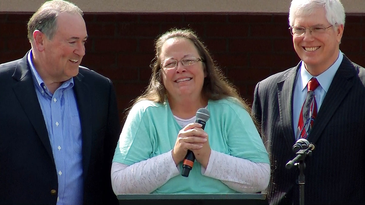 Kentucky clerk Kim Davis –flanked by presidential candidate Mike Huckabee (left) and her attorney, Mathew Staver – at a Tuesday, Sept. 8, 2015 rally outside the jail where she was held for several days in the wake of her refusal to issue same-sex marriage couples wedding licenses.