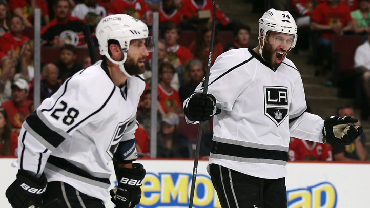 Jarret Stoll #28 and Dwight King #74 celebrate teammate Justin Williams #14 of the Los Angeles Kings goal against Corey Crawford #50 of the Chicago Blackhawks in the first period during Game Seven of the Western Conference Final in the 2014 Stanley Cup Playoffs at United Center on June 1, 2014 in Chicago, Illinois.