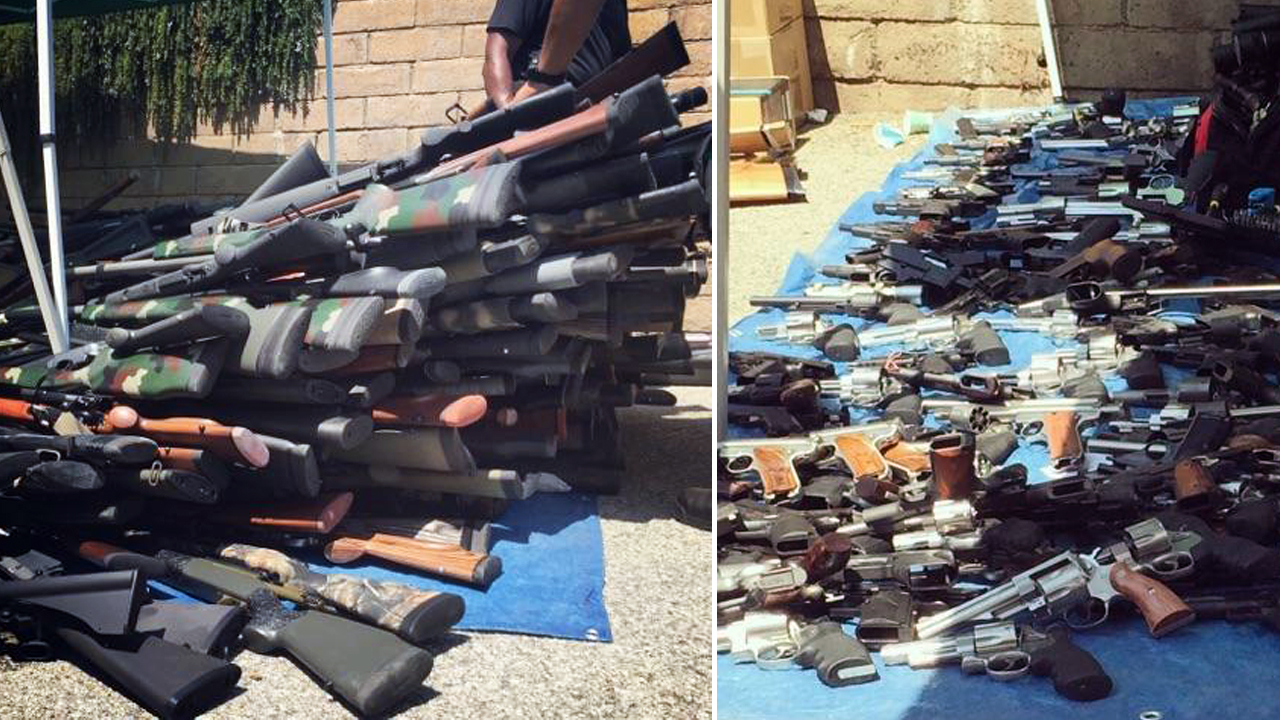 More than 1,200 guns - including handguns, shotguns and rifles - and an estimated two tons of ammunition were found at a West LA home. Part of the stockpile is seen in this undated photo provided by sources.