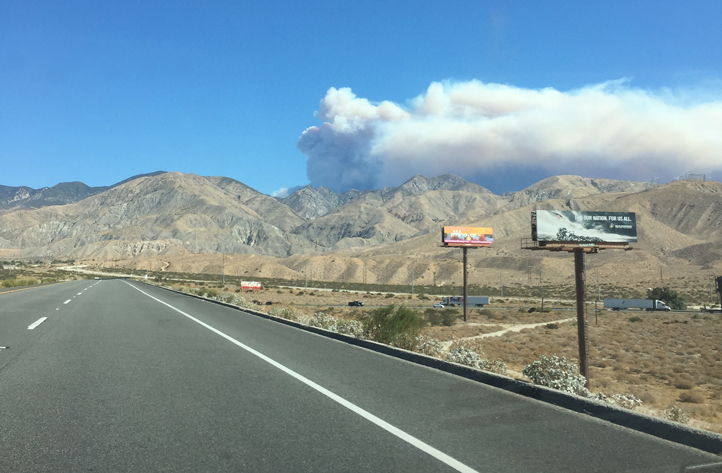 Smoke billowed from a wildfire being called the
