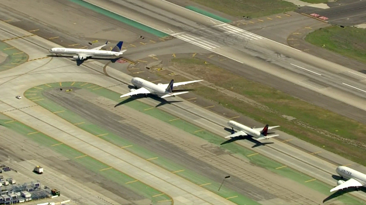 Planes sit at the Los Angeles International Airport as computer problems forced the FAA to ground flights heading into the Southern California airspace on Wednesday, April 30, 2014.