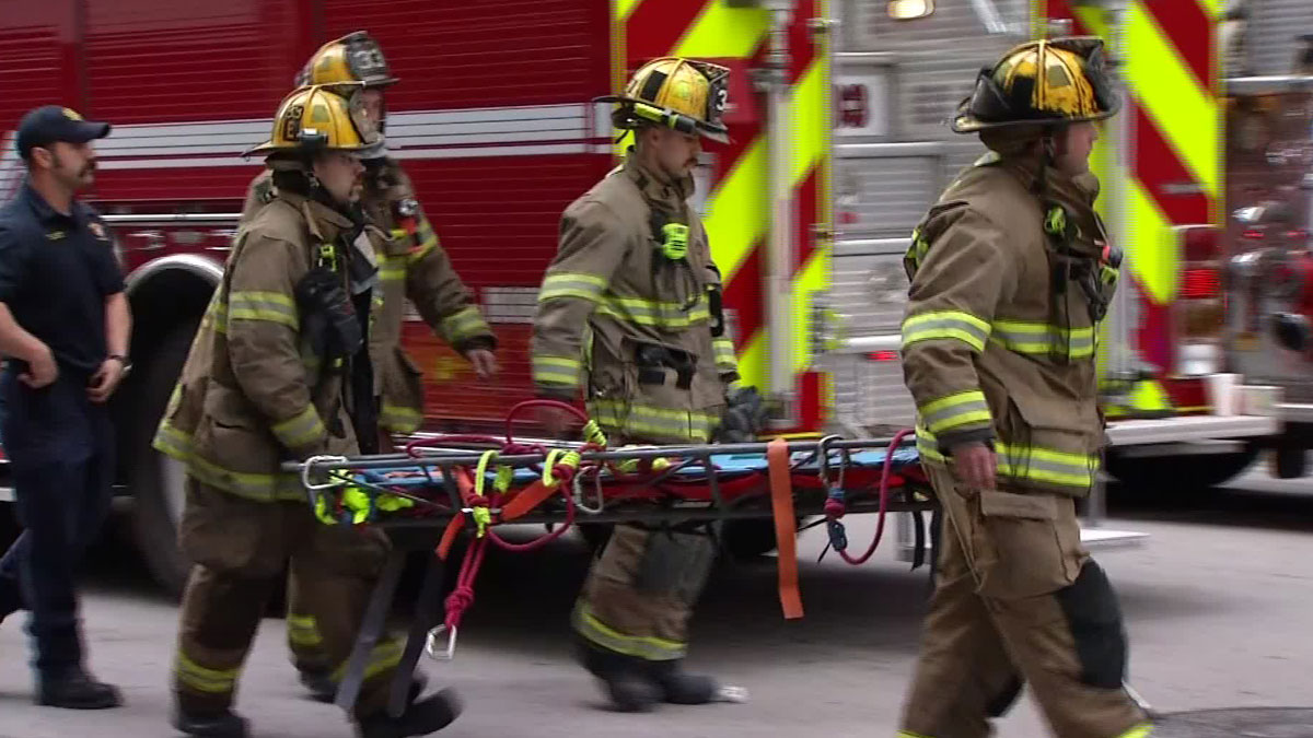 A 3-alarm electrical fire in the parking of Thanksgiving Tower in downtown Dallas Thursday morning led to the evacuation of 2,800 people and hospitalized two people.