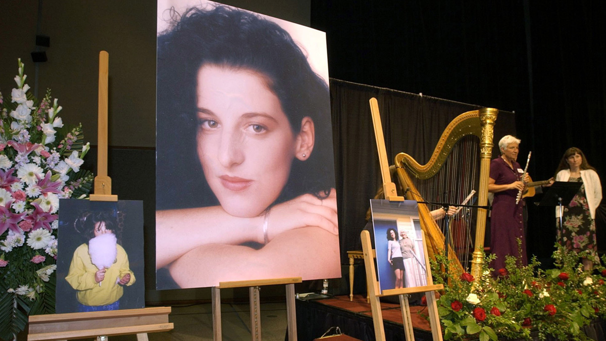 In this May 28, 2002, file photo, photos of Chandra Levy are on display as musicians, right, stand by at the memorial service for Levy.