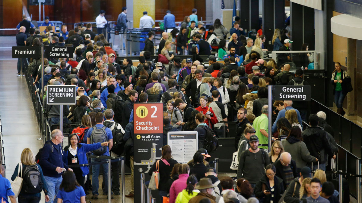 In this March 17, 2016, photo, travelers wait in line for security screening at Seattle-Tacoma International Airport in Seattle.