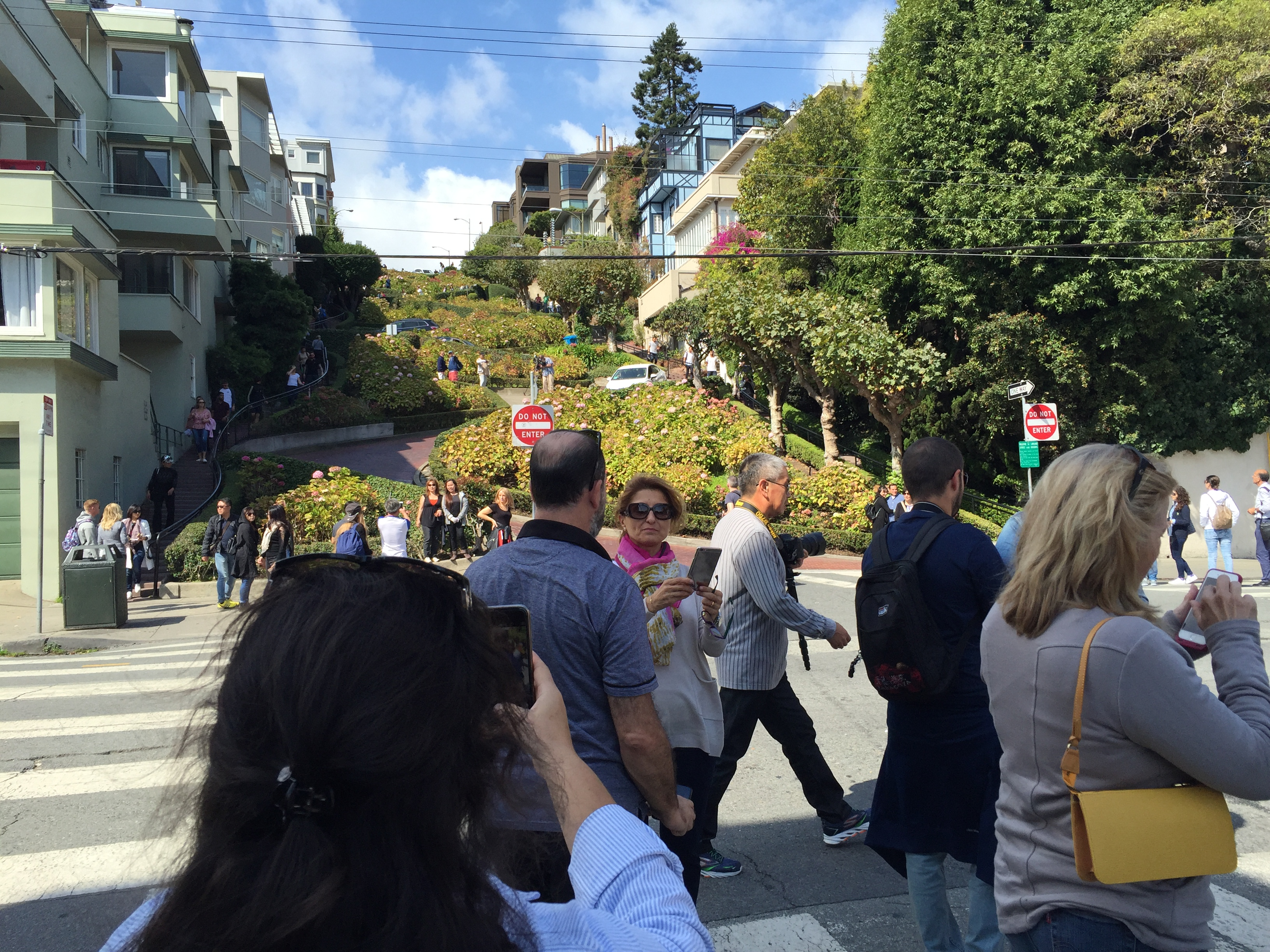 Tourists snap pictures on Lombard Street in San Francisco where a toll is being proposed as one idea to relieve traffic congestion. Sept. 13, 2016